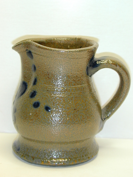 Side view of a small decorated pitcher. ai11.