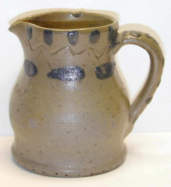 Side view of A Present pitcher. ai14.