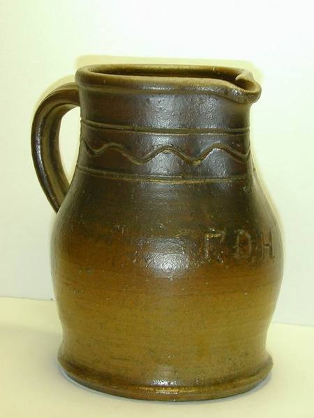 Incised decorated pitcher with the initials F.D.H. aiI5.