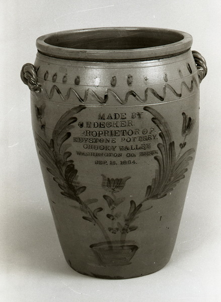 This jar, considered by many to be Charles Decker, Sr.'s masterpiece, is dated Sep. 16, 1884 and is 26 inches high and 55 inches in diameter. It won blue ribbons at regional fairs and served to advertise Decker pottery. ai20.