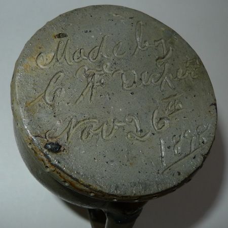 The bottom of A Present pitcher signed in script. ai21.