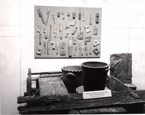 Photograph from an early exhibit showing Charles, Sr.'s wheel, tools and pottery. Burbage20.