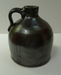 Small dark slip covered jug. ai26.