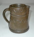 Slip covered pitcher with wavy line decoration. ai31.