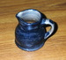 Small cobalt covered pitcher dated 1906. ai39.
