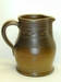 Medium sized presentation pitcher with incised line decoration and the initials F.D.H. ai8.